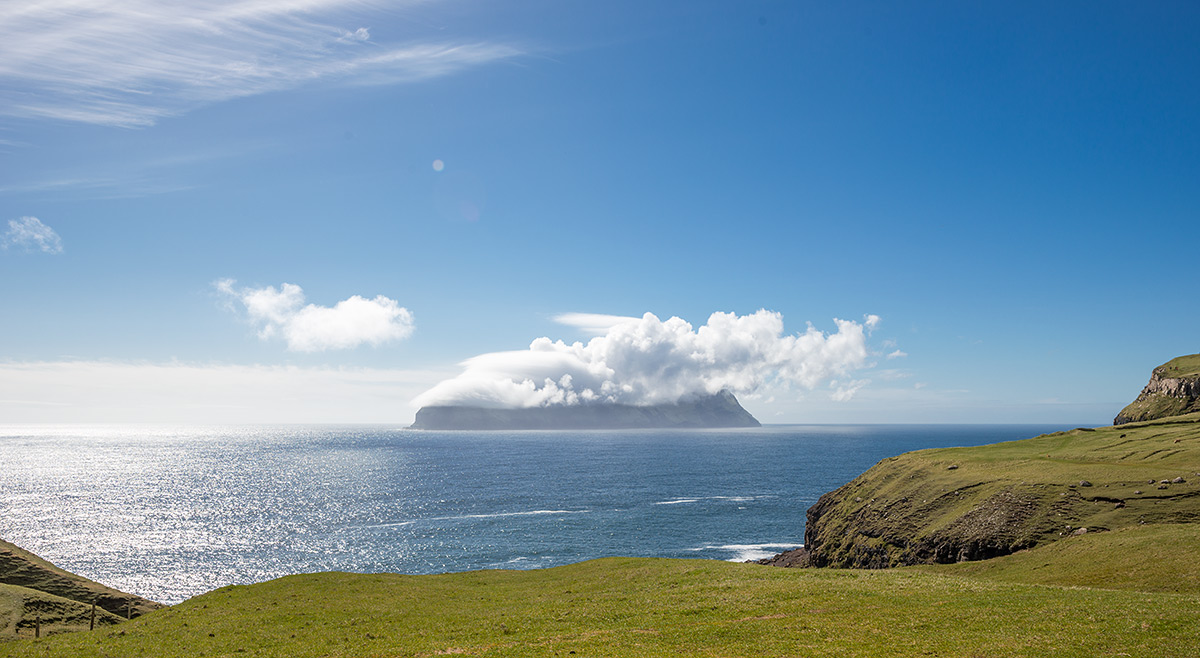Mykines island covered by clouds